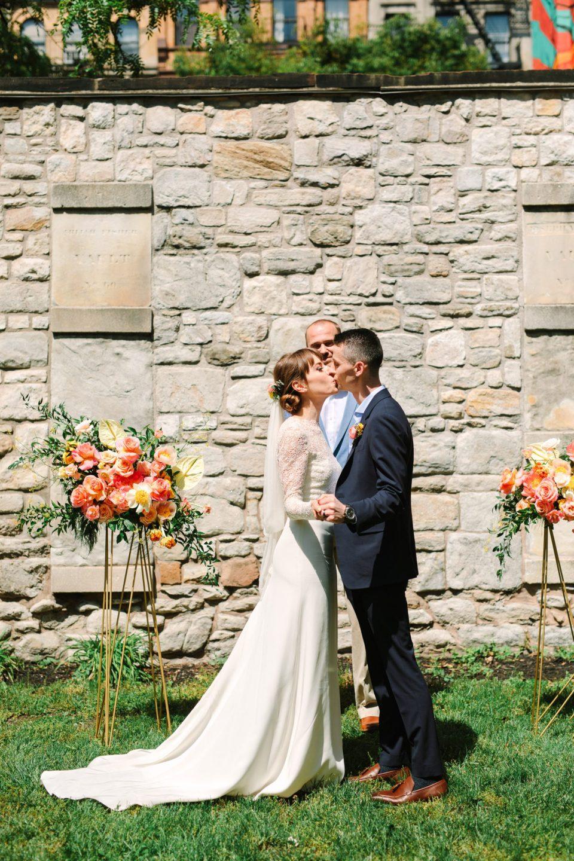 Bride and groom's first kiss - www.marycostaweddings.com