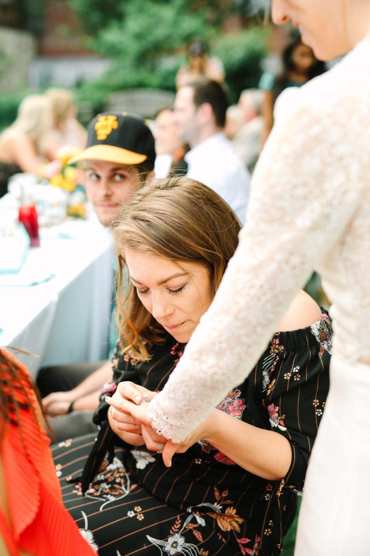 Guest admiring wedding ring - www.marycostaweddings.com