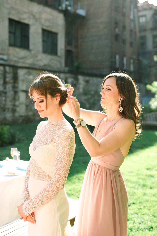 Bride having her hair fixed - www.marycostaweddings.com