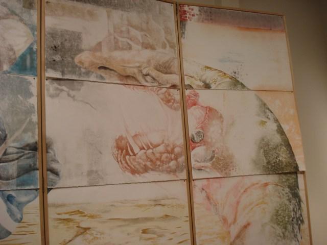 """The face of Jörmungandr in Ian Warner's """"Saga."""" Jörmungandr is symbolic of the Red River in this work."""