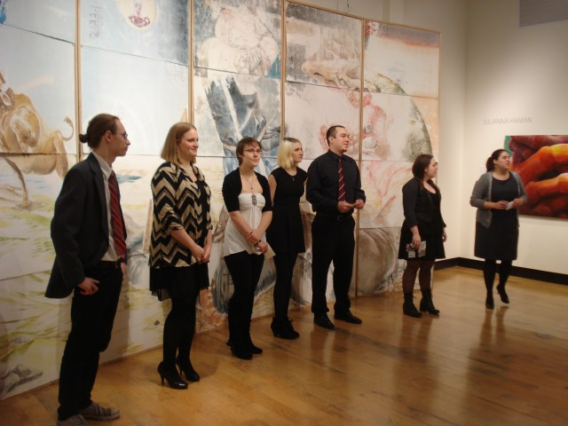 Ian (on the left) and the rest of the students showing their senior art work at their Baccalaureate exhibit, NDSU, November 25, 2014. (The professor introducing the group is on the right.)