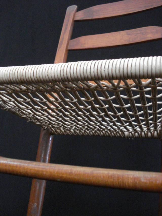 Ladder-back chair, looking up at bottom of caned seat, photo by Mary Warner, February 2015.