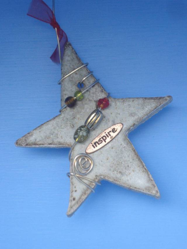 """The """"Inspire"""" star (given to me by my friend Ann Marie) inside our Little Free Library, June 10, 2016. Photo by Mary Warner."""