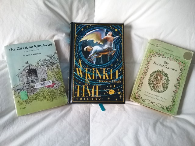 """3 childhood books: """"The Girl Who Ran Away"""" (aka """"Charley""""), """"A Wrinkle in Time"""" trilogy, and """"The Secret Garden."""" Photo by Mary Warner, 2018."""