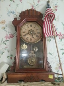 Mantle clock with American flag, 2018.