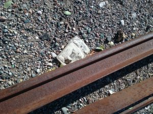 Old railroad tracks with litter, 2018.