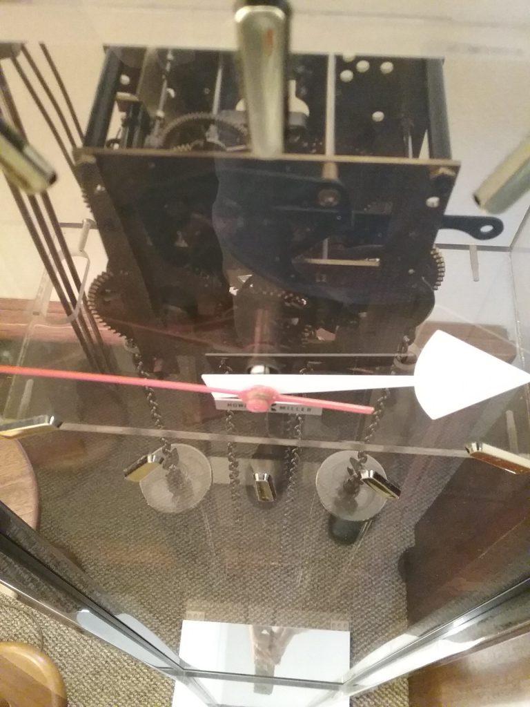 Interior workings of a Herman Miller transparent floor clock, 2018.