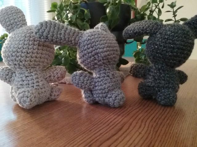 Backs of three amigurumi fertility bunnies from pattern by Sir Purl Grey, by Mary Warner, 2020.