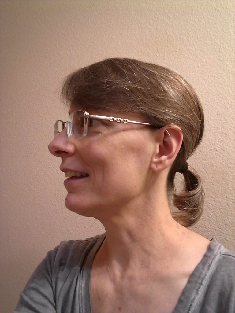 Pandemic hair made less unruly by binding it back into a ponytail, Mary Warner, March 13, 2021.