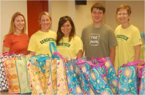 Genentech employees help assemble customized swim bags for Marygrove residents
