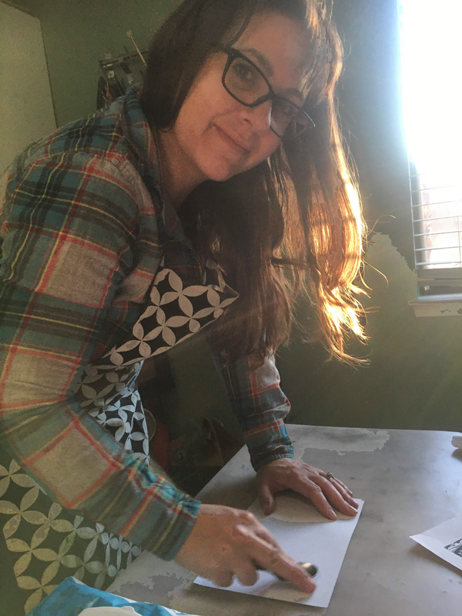 About Artist Mary Vasquez hand pressing her Linocut prints.