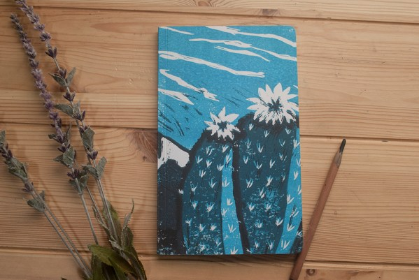 This is a photo of a turquoise cactus flower notebook