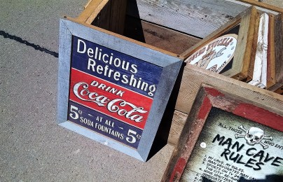 In my Coke collecting days, this would have surely interested me. The other sign is for the guys.