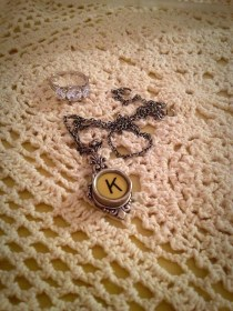 My newest most favorite piece of jewelry by my other favorite piece of jewelry. The ring, of course, and then a necklace the sister gave me with a typewriter key.