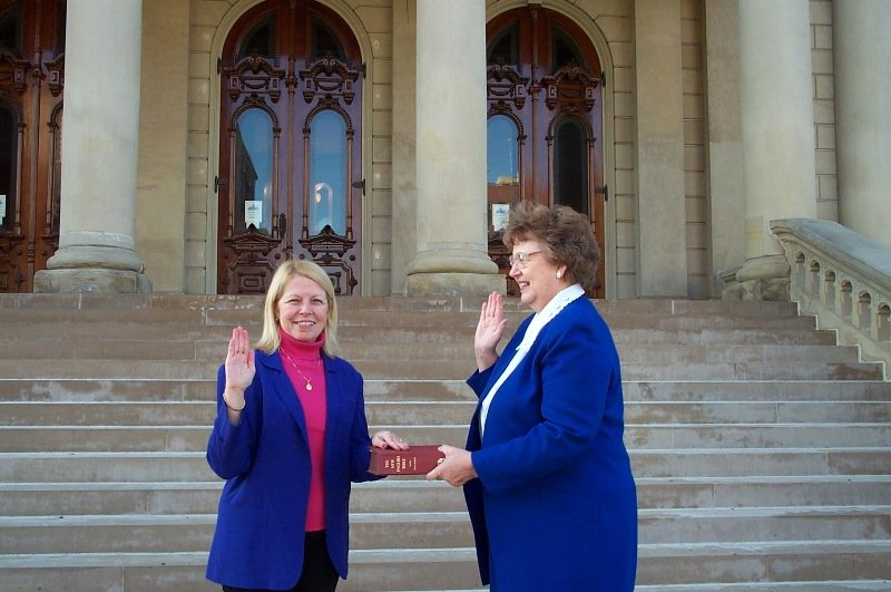 Clerk Virginia White Administering the Oath of Office to Dr. Davis on the Michigan Capital steps