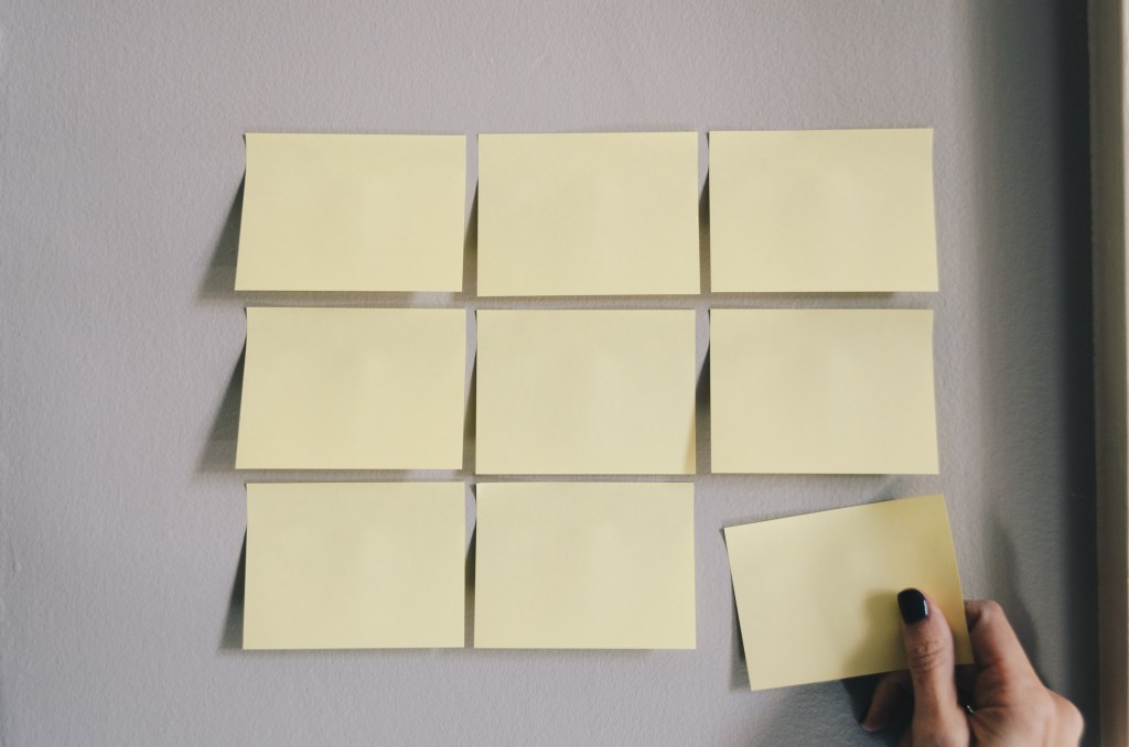 postits sticking to a board