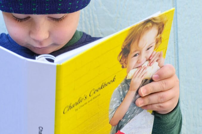 Child reading cookbook