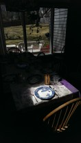sunlight shines brightly at one end of the table