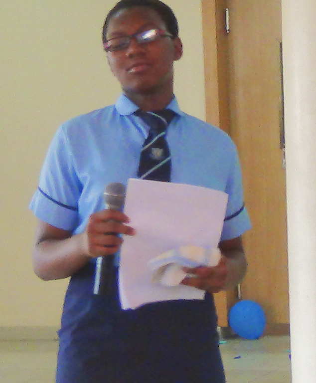 student-dim-chidiogo-giving-a-speech-about-world-labour-day_17593665592_o