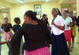 sr-gertrude-dancing-with-her-staff-and-students_17569657756_o