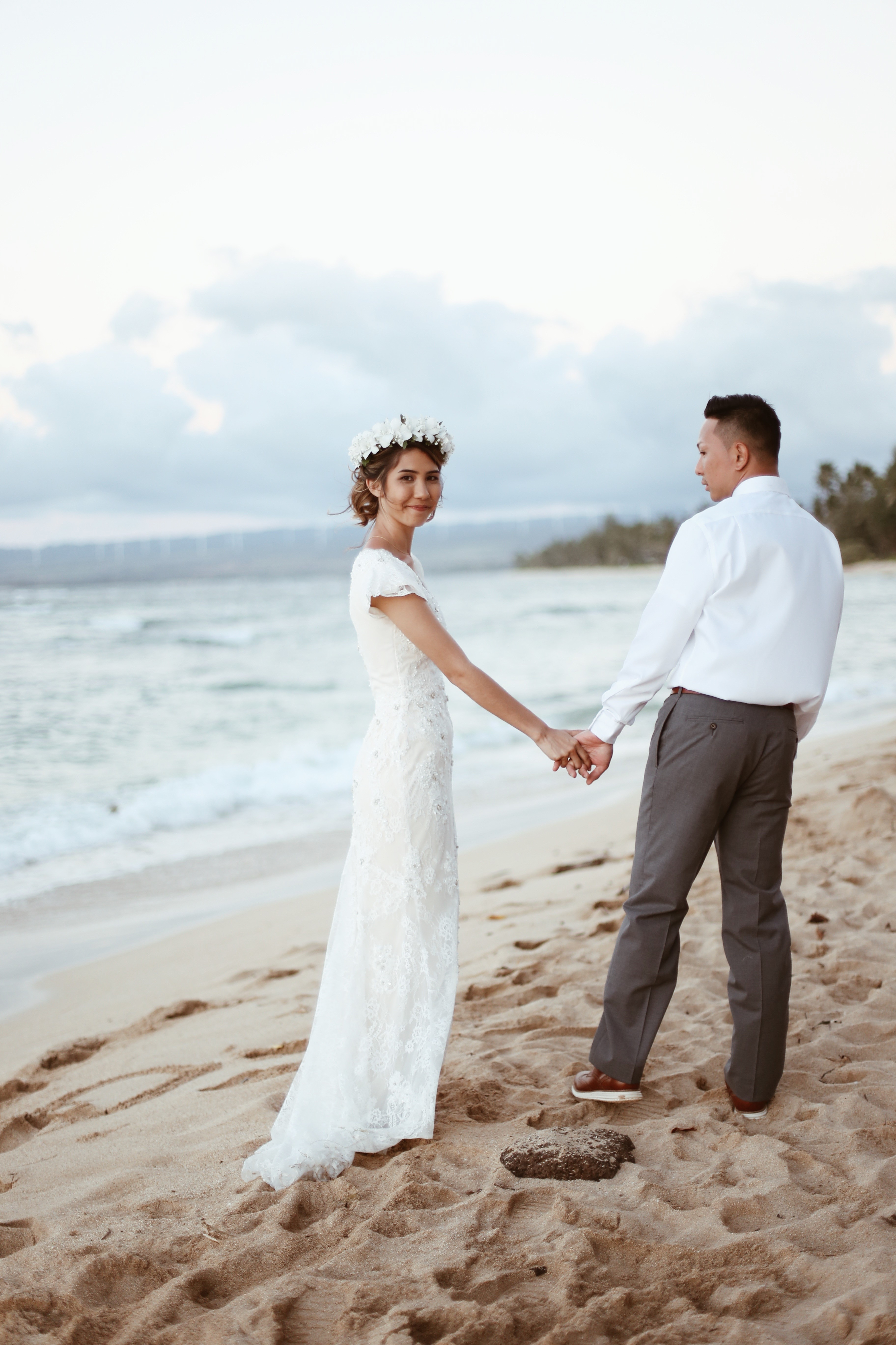 Sadie added flutter cap sleeves and covered her illusion lace back in a lightweight, lace sheath gown