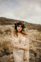 Haku lei and blush off the shoulder wedding dress at Masako Formals Hawaii