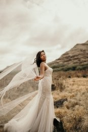 Cathedral veil and mermaid wedding dress at Masako Formals Hawaii