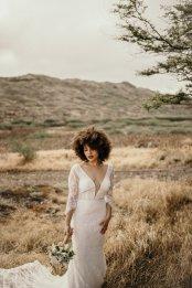 Long sleeve lace low v, low back wedding dress by Casablanca Bridal at Masako Formals