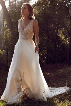 Beaded deep v bodice wedding dress with flowing chiffon A line skirt by Justin Alexander