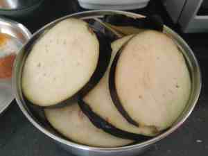 Eggplants sliced and soaked in water to avoid discolouration