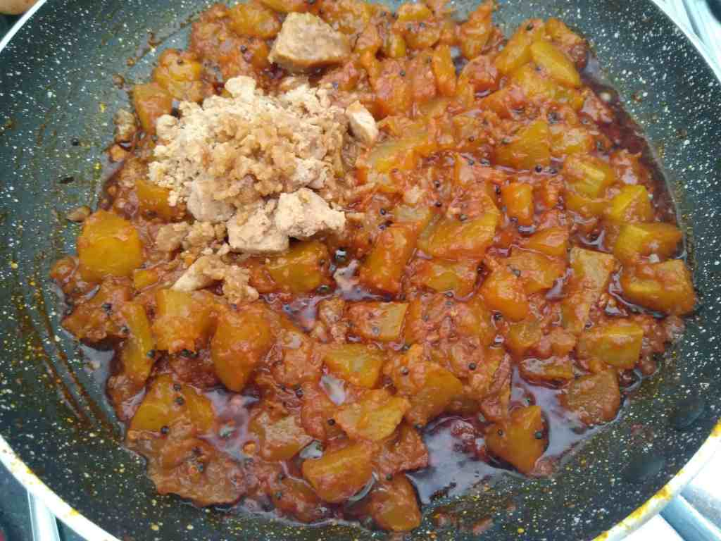 Adding jaggery to the pickle for the sweet touch