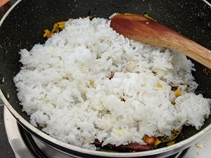 Adding cooked rice to nellikai mix