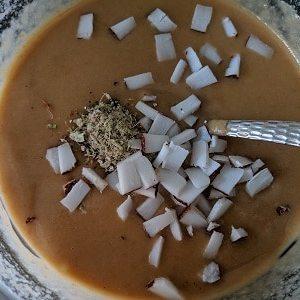 Adding coconut and cardamom