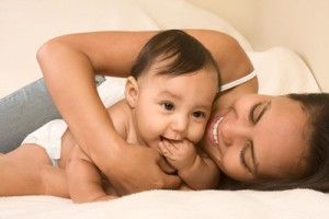 bigstock_Mother_Playing_With_Her_Baby_B_3190944