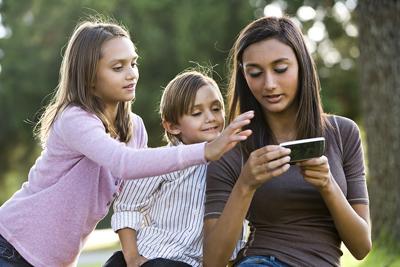 bigstock-Teenage-girl-with-mobile-phone-7238359