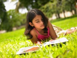 bigstock-Asian-Girl-Reading-A-Book-In-T-3823001