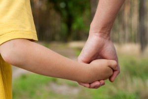 bigstock-Mother-holding-a-hand-of-his-s-30102413