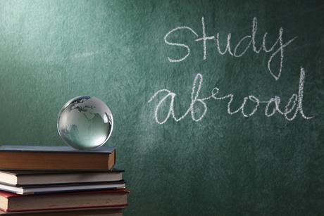 bigstock-glass-globe-on-the-book-26760962