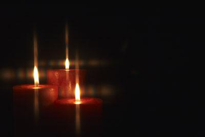 bigstock-Closeup-of-burning-candles-iso-27304853