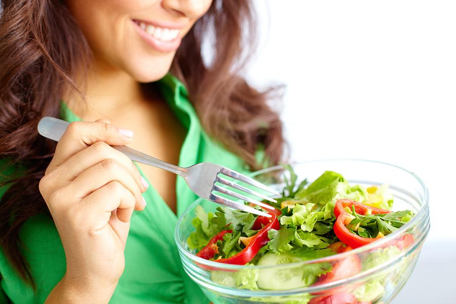 girl eating fresh vegetable diet salad