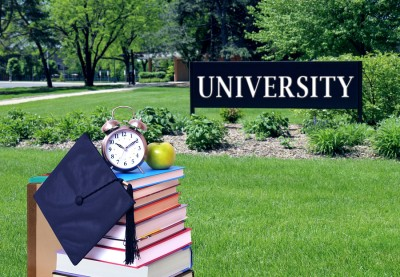 education concept with book and university campus