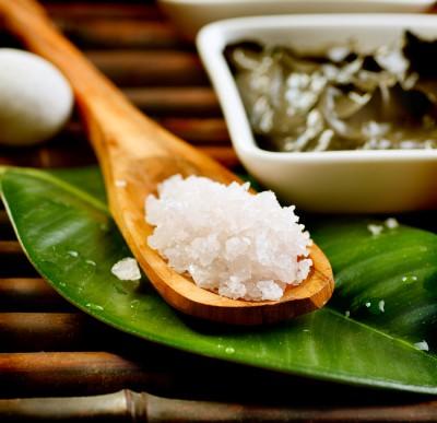 Spa Salt in wooden spoon closeup. Bath salt. Sea Spa treatments