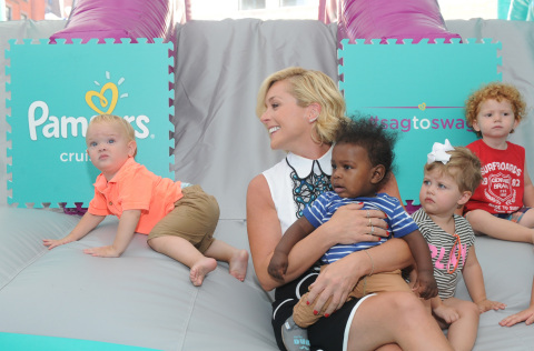 Actress and mom Jane Krakowski plays with babies at the launch of the Pampers Cruisers #SagToSwag Tour in New York, Wednesday, Aug. 12, 2015.   In celebration of the new and improved Pampers Cruisers diapers, Pampers is going on a national tour to transform the nationÕs babies from Òsag to swagÓ one bottom at a time.  (Photo by Diane Bondareff/Invision for Pampers/AP Images)
