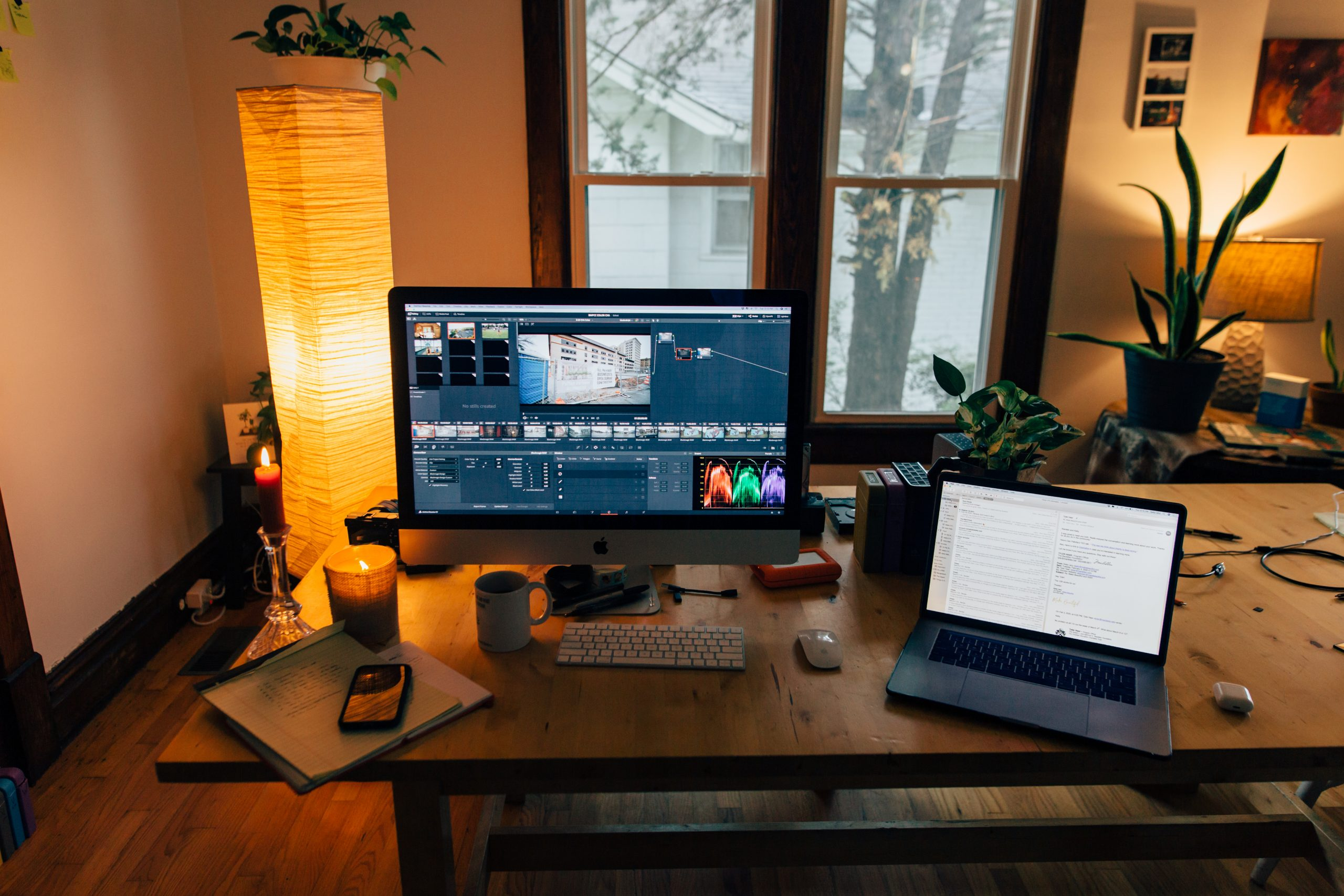 Modern workplace with gadgets in cozy room with soft light