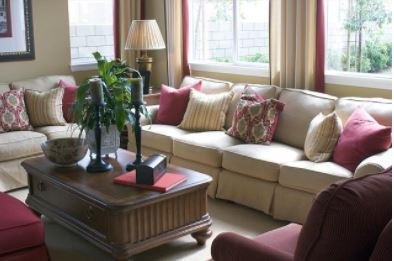Family Room with raspberry throw pillows