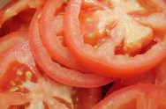 Sliced tomatoes may be eating with or without salad dressings.