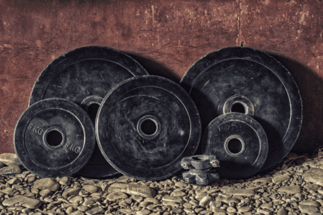 bumper plates against a wall