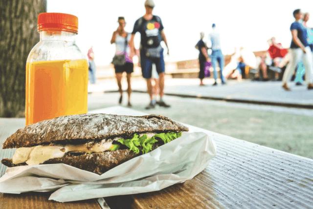 couple walking in the background of a sandwich and orange juice fat loss mason woodruff