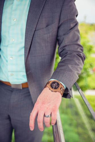 man wearing jord conway series walnut jet black unique wood watch joseph aboud gray suit leaning against railing