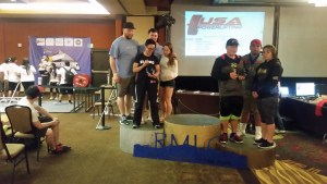 Lifters Matt Cassista, Emily Liebert and Lodrina Cherne accept the combined team second place award for Team Baystate with Stephen King who was one of many handlers assisting Massachusetts lifters over the three day meet.